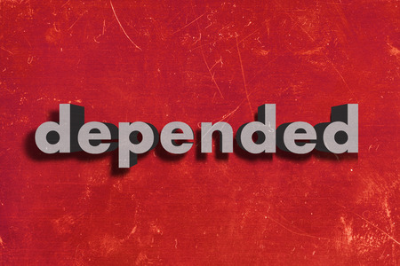 depended: gray word on red wall