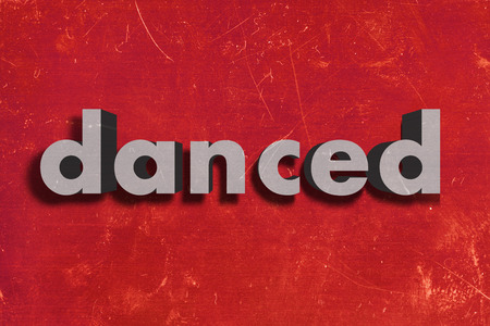 danced: gray word on red wall