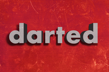 darted: gray word on red wall