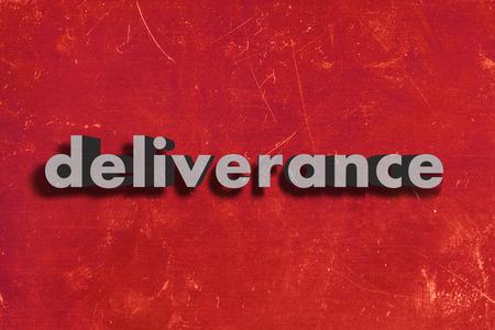 d�livrance: mot gris sur le mur rouge Banque d'images