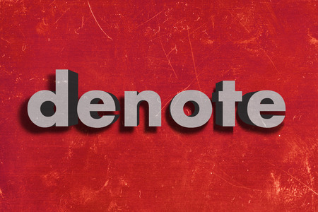 denote: gray word on red wall