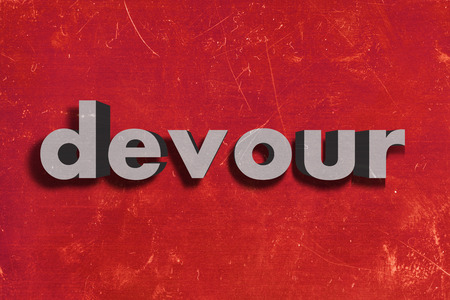 devour: gray word on red wall