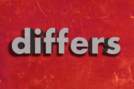 differs: gray word on red wall