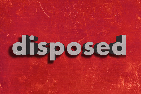 disposed: gray word on red wall