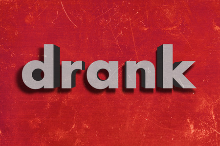 drank: gray word on red wall