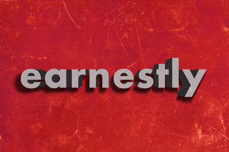 earnestly: gray word on red wall
