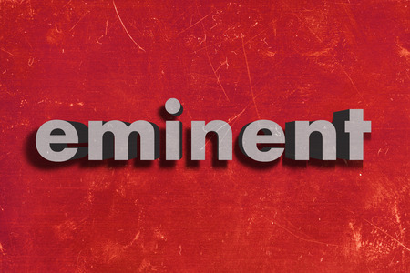 eminent: gray word on red wall