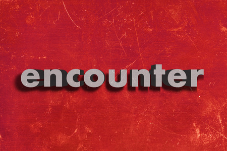 encounter: gray word on red wall