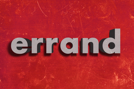 errand: gray word on red wall