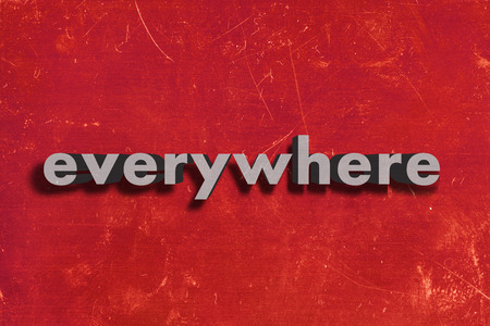 everywhere: gray word on red wall
