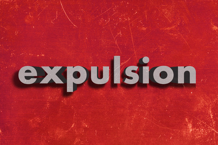 expulsion: gray word on red wall
