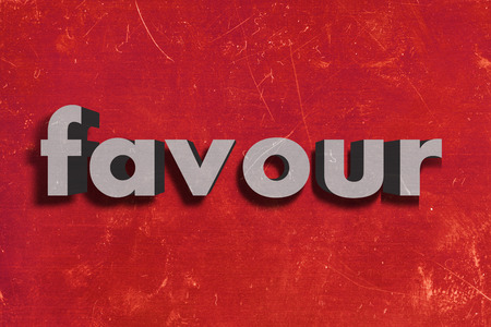 favour: gray word on red wall