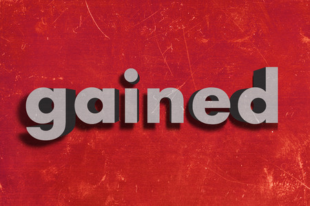 gained: gray word on red wall