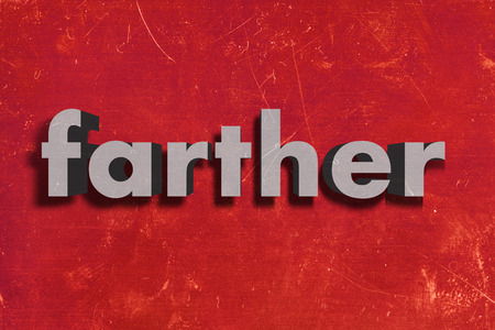 farther: gray word on red wall