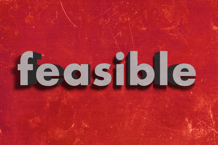 feasible: gray word on red wall