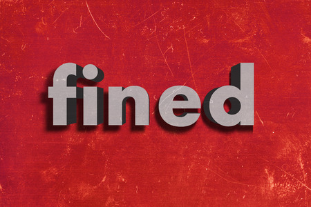 fined: gray word on red wall
