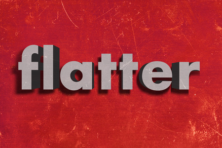 flatter: gray word on red wall