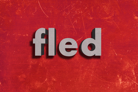fled: gray word on red wall