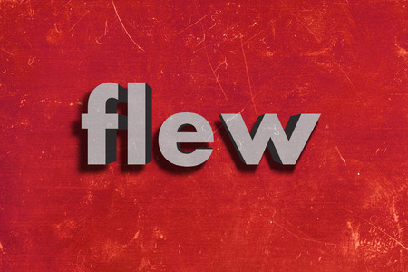 flew: gray word on red wall