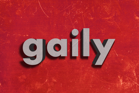 gaily: gray word on red wall
