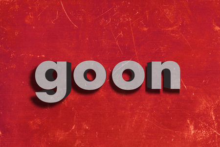 goon: gray word on red wall