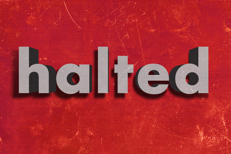 halted: gray word on red wall
