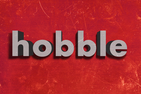 hobble: gray word on red wall