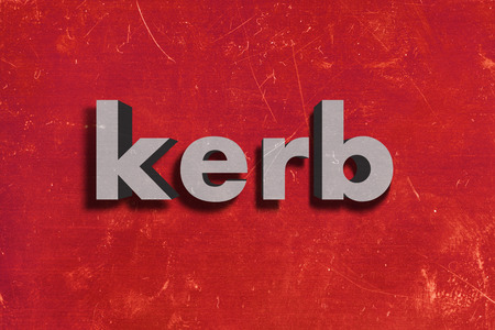 kerb: gray word on red wall