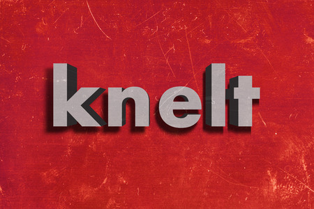 knelt: gray word on red wall