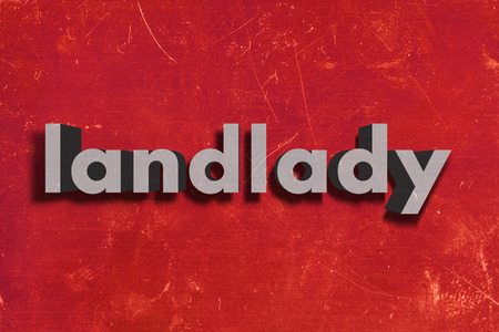 landlady: gray word on red wall