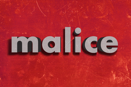 malice: gray word on red wall