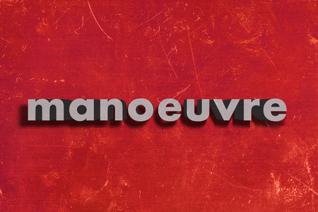 manoeuvre: gray word on red wall