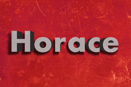 horace: gray word on red wall