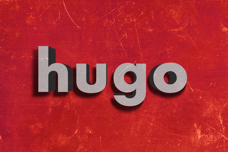 hugo: gray word on red wall