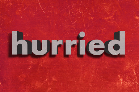 hurried: gray word on red wall