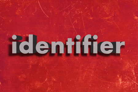 identifier: gray word on red wall