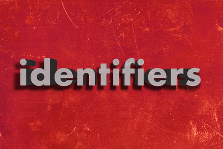 identifiers: gray word on red wall