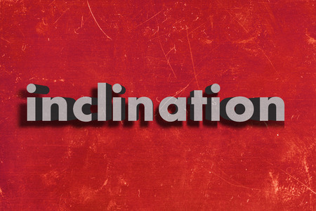 inclination: gray word on red wall