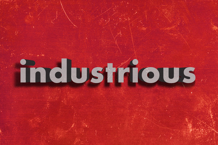 industrious: gray word on red wall