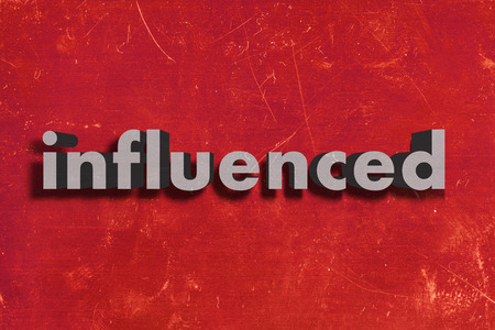 influenced: gray word on red wall