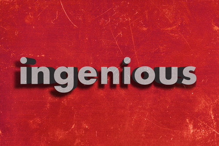 ingenious: gray word on red wall