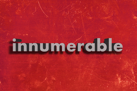 innumerable: gray word on red wall