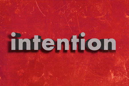 intention: gray word on red wall