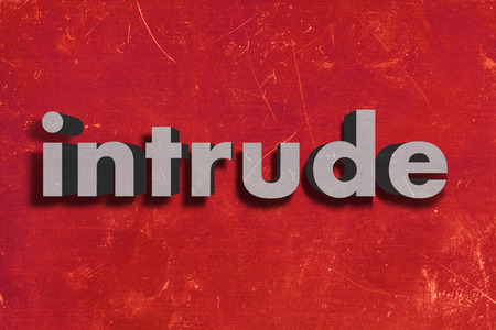 intrude: gray word on red wall
