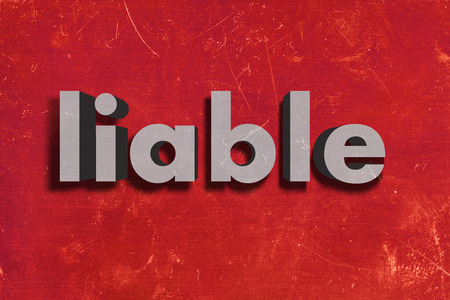 liable: word on red wall