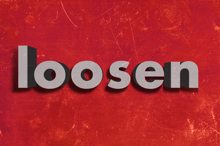 loosen: word on red wall
