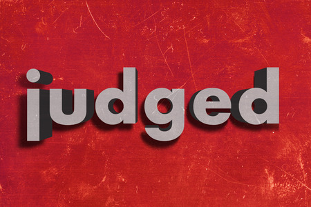 judged: gray word on red wall