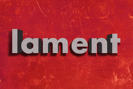 lament: gray word on red wall