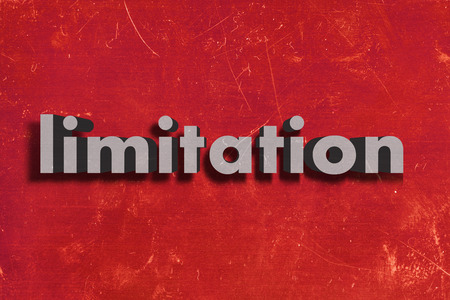 limitation: gray word on red wall