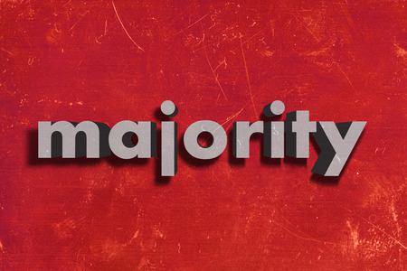 majority: gray word on red wall